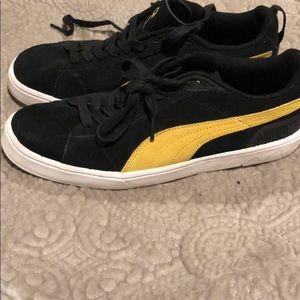 08a6fa4a304294 Puma Shoes - Men s Puma black and gold sneakers size 9 1 2